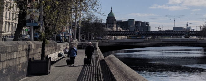 Couple walking along the bank of the River Liffey